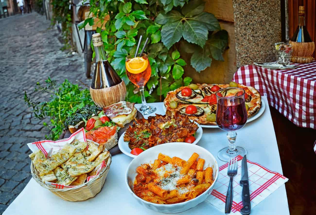 Italian food in outdoor restaurant in Trastevere district in Rome